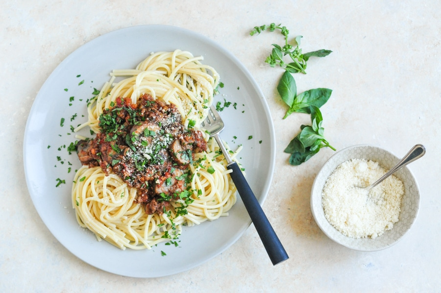 vietnamese spaghetti bolognese on plate with herbs