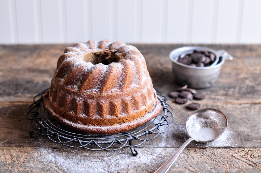 chestnut cake with chocolate chips on wire rack
