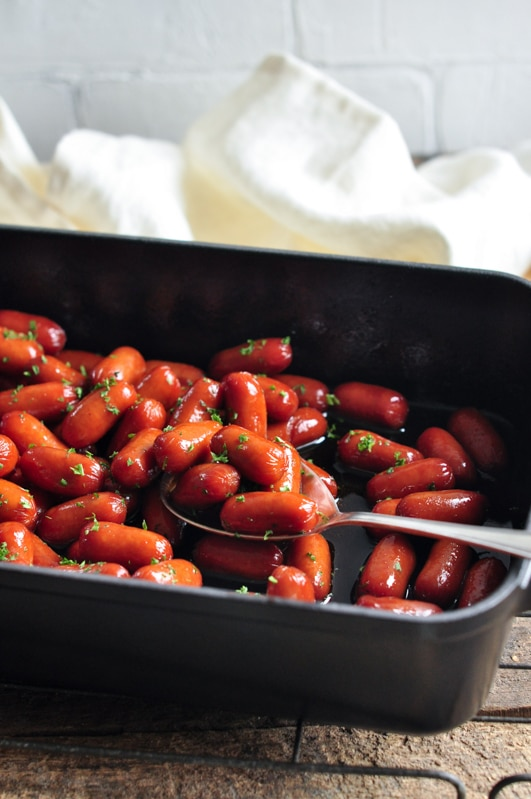 honey soy sriracha cocktail sausages in roasting tray
