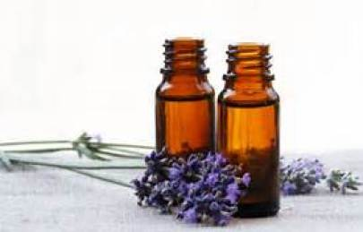 Lavender Essential oils in bottle with flowers