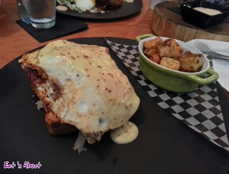 Open Faced Corned Beef Sandwich with overeasy eggs, sauerkraut, dijon and home fries at The Oakwood Canadian Bistro