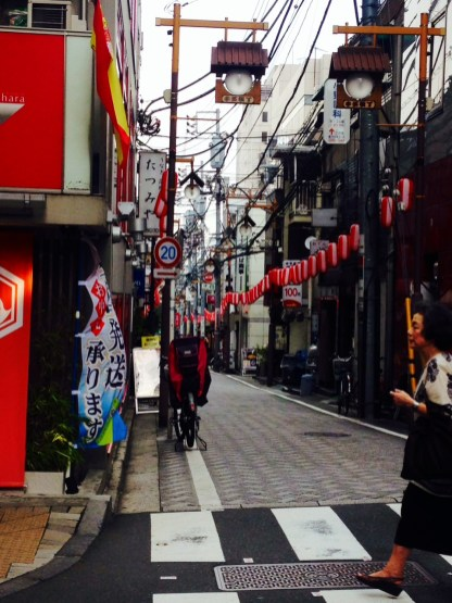 Cobblestone alleyways lined with red lanterns signaling the upcoming matsuri!