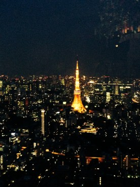 Tokyo Tower lighting up the skyline, view from Mori Art Center Sky Deck