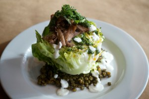 Butter lettuce with warm lentils, roasted lamb neck, and yogurt from Little Bird Bistro. Photo credit: David Reamer.
