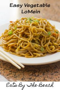 White plate with easy vegetable lo mein and chopsticks on the side