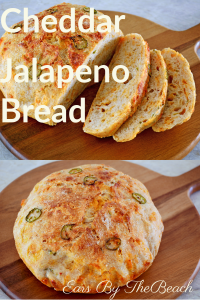 Loaf of sliced cheddar jalapeno bread on a wooden board
