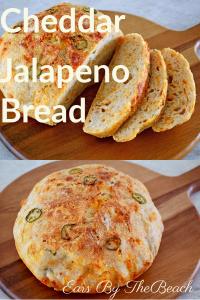 Loaf of sliced cheddar jalapeno bread on a wooden board