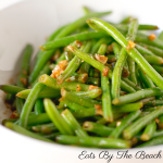 Dish of sauteed haricot verts, a french green bean, in butter and shallots.
