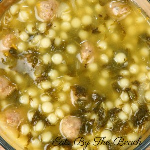 Hot bowl of Italian Wedding soup with shredded chicken, metballs, broth, and Parmesan cheese.