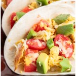 Vegetarian Migas tacos with eggs, onion, jalapeno, fried corn tortilla pieces, and cheese. A Tex-Mex recipe.