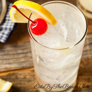 A Vodka cocktail of vodka, lemon juice, simple syrup, and soda. This Vodka Tom Collins is then garnished with a lemon slice and a maraschino cherry.