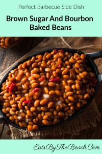 Dutch oven full of Brown Sugar And Bourbon Baked Beans - made with bacon, brown sugar, onions, red bell pepper, and bourbon.