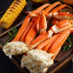 Easy Steamed Snow Crab Legs steamed with parsley, lemon, shallots, and Old Bay Seasoning.