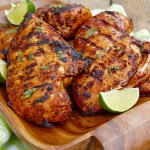 This easy grilled tequila lime chicken is full of spicy Southwest flavor and yet is easy enough for a weeknight meal. I love keeping a container of grilled, boneless, skinless chicken breasts in my fridge. They make it so easy to slice and put on a salad or a sandwich. Anything that makes life easier, am I right? Grilled tequila lime chicken is great served with Southwest Quinoa Salad, Mexican Grilled Corn, and a few Southern Hushpuppies. HOW DO I MAKE THIS RECIPE? Because boneless, skinless chicken can get dry, especially on the grill, we are going to infuse the chicken with tons of flavor by marinating it in citrus juices, spices, oil, and tequila. The tequila not only adds a punch of flavor, but it also helps to tenderize the proteins. Next, we will reserve some of the marinade and reduce it to a thick syrup. This will be our basting sauce while grilling to add additional moisture and flavor. Pour the remainder of the marinade into a ziplock bag, toss in the chicken, and chill in the refrigerator for at least 4 hours, but overnight is better. Then, lay those babies on the grill, turning them once or twice and slathering the rich, flavorful sauce on them. VARIATIONS TO THIS RECIPE You can use any kind of tequila in this recipe. I used white tequila (Blanco), because its what I had on hand. If you don't have limes or oranges on hand, use any type of citrus - just be sure to adjust the brown sugar to reach the desired sweetness. You can vary the spices by using smoked paprika or different types of chili powder. Try minced, fresh cilantro instead of coriander powder. If you want to limit the heat, be sure to remove the seeds and all veins from the jalapeno or eliminate the pepper all together. Looking for more chicken recipes? Here are a few suggestions to try: Chicken Vesuvio Chicken Marbella Grilled Piri Piri Chicken Sticky And Spicy Sriracha Chicken Drumsticks Perfectly Moist Boneless Skinless Chicken Breasts