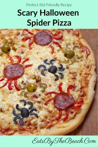 Homemade Scary Halloween Spider Pizza - a cheese pizza with spiders made from pepperoni, black and green olives.