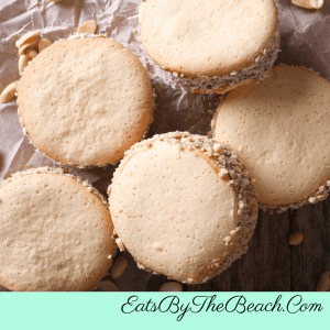 Argentinian Alfajores cookies with nuts coated on the sides.