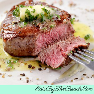 Filet mignon with butter and herbs.
