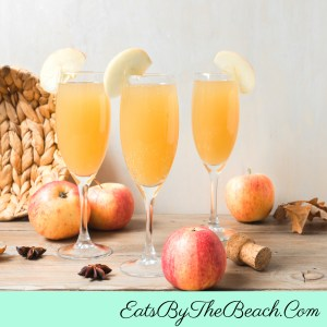 Champagne flute of caramel apple mimosas - apple cider, caramel-flavored vodka, and prosecco makes for a great Thanksgiving brunch cocktail.