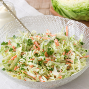 Bowl of Southern Style Cole Slaw - shredded cabbage and carrots in a sweet and tangy mayonnaise based dressing.