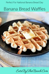 Plate of banana bread waffles with butter, pecans, and maple syrup.