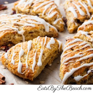 Platter of fruit and nut oatmeal scones drizzled with vanilla glaze