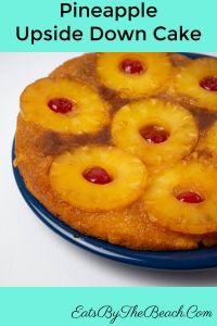 A plate with Pineapple Upside Down Cake - almond-scented cake with a buttery, caramelized fruit top.