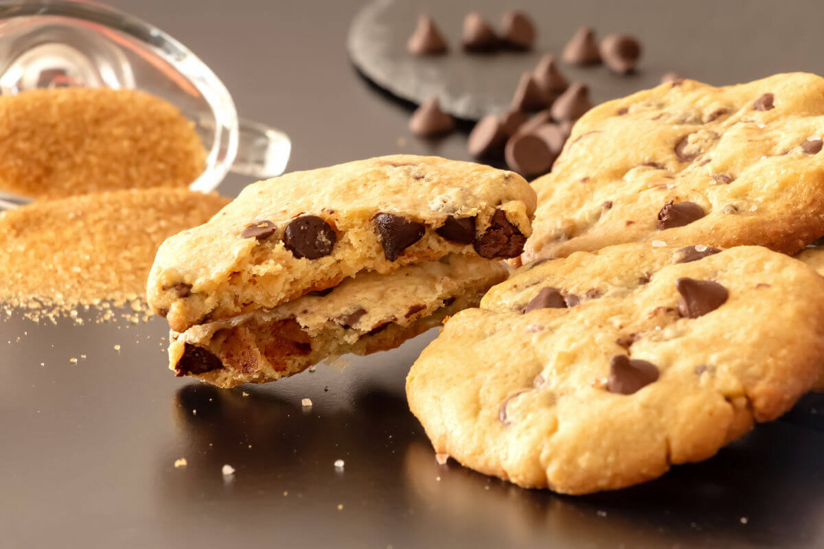 Slate platter of buttery, salted caramel chocolate chip cookies