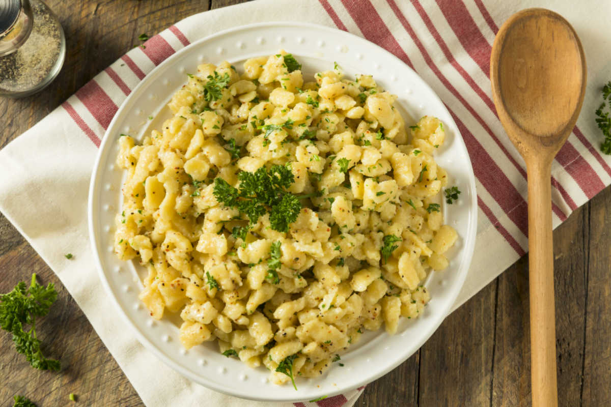 Bowl of homemade Parslied German Spaetzle garnished with chopped parsley.