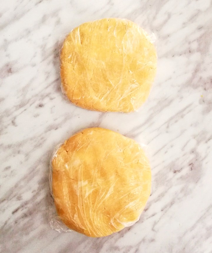 pie crust wrapped in plastic wrap and shaped into disks