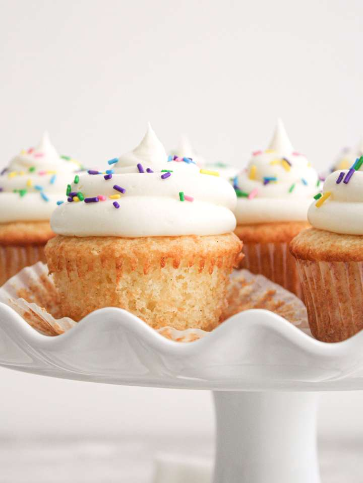 easy vanilla cupcakes on cake stand unwrapped