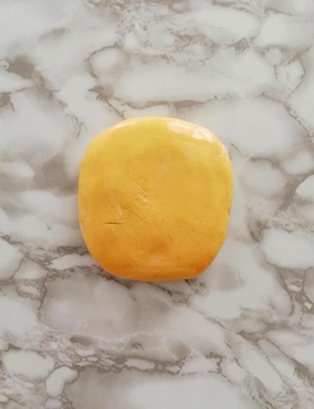 apricot jam filled sandwich cookie dough wrapped in plastic wrap