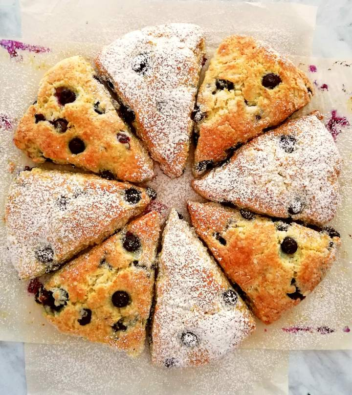blueberry scones dusted with powered sugar overhead