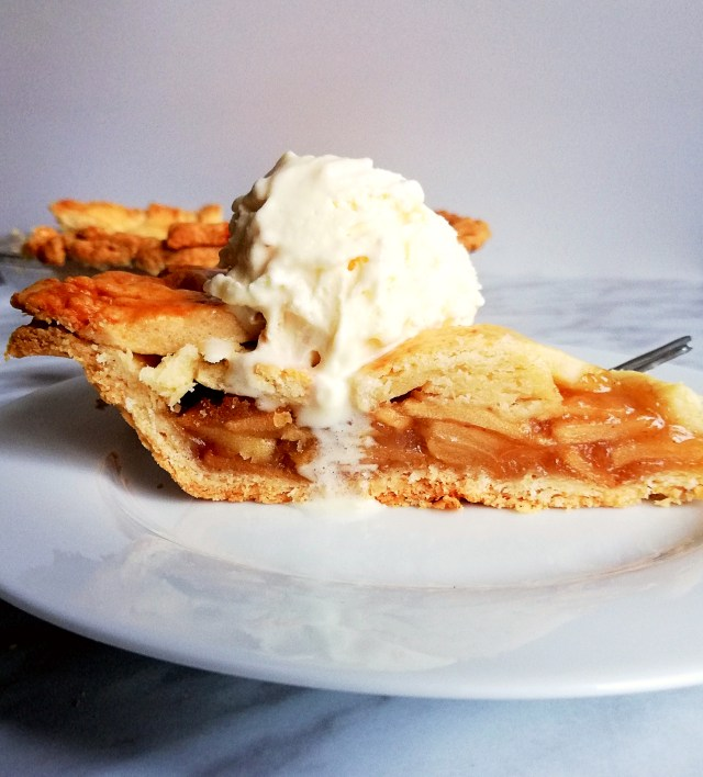 apple pie slice with ice cream side view
