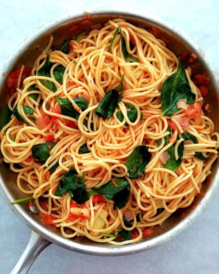 spinach pasta in skillet