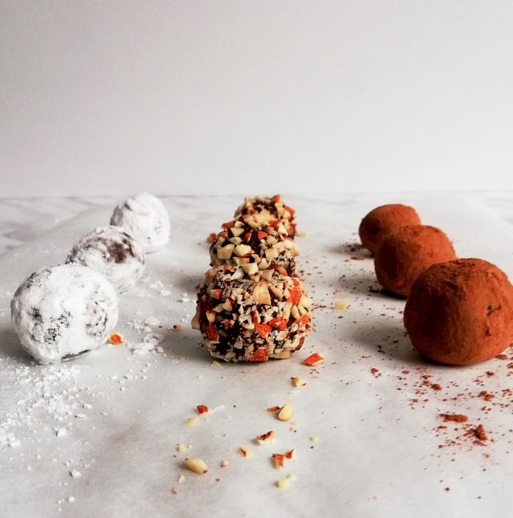 chocolate truffles rolled in nuts, powdered sugar, cocoa