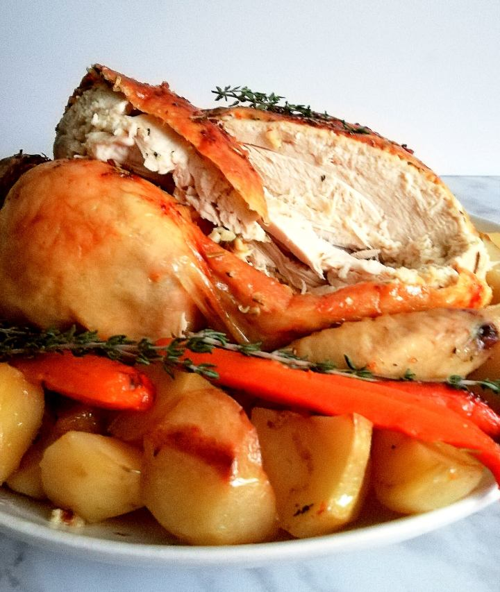 herb roasted chicken with potatoes and carrots inside view
