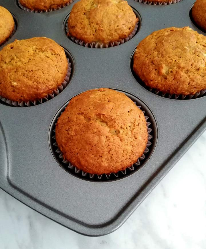 baked banana muffins in tray close up