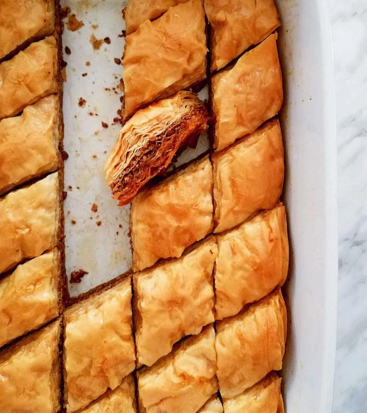 baklava in baking dish with slice sideways