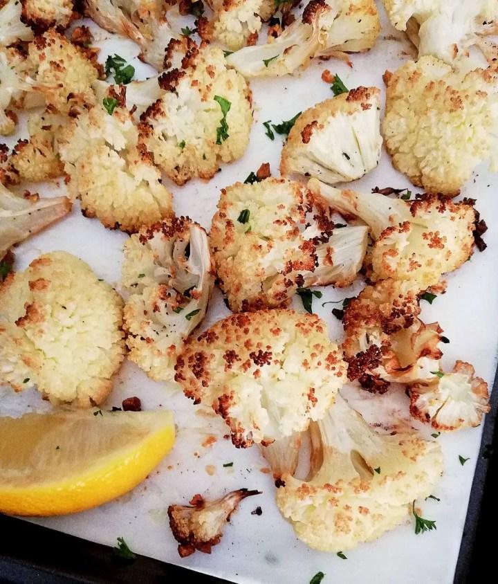 roasted cauliflower on baking sheet close up