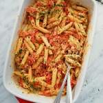 baked feta pasta in baking dish garnished