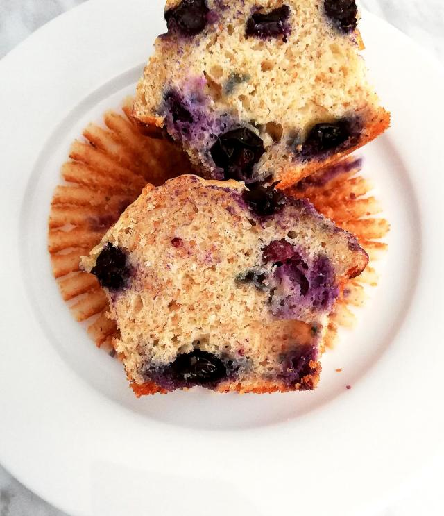 healthy blueberry banana muffins halved on plate