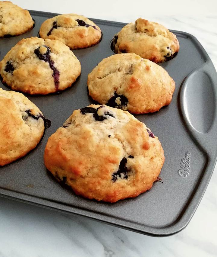 healthy blueberry banana muffins in muffin tin