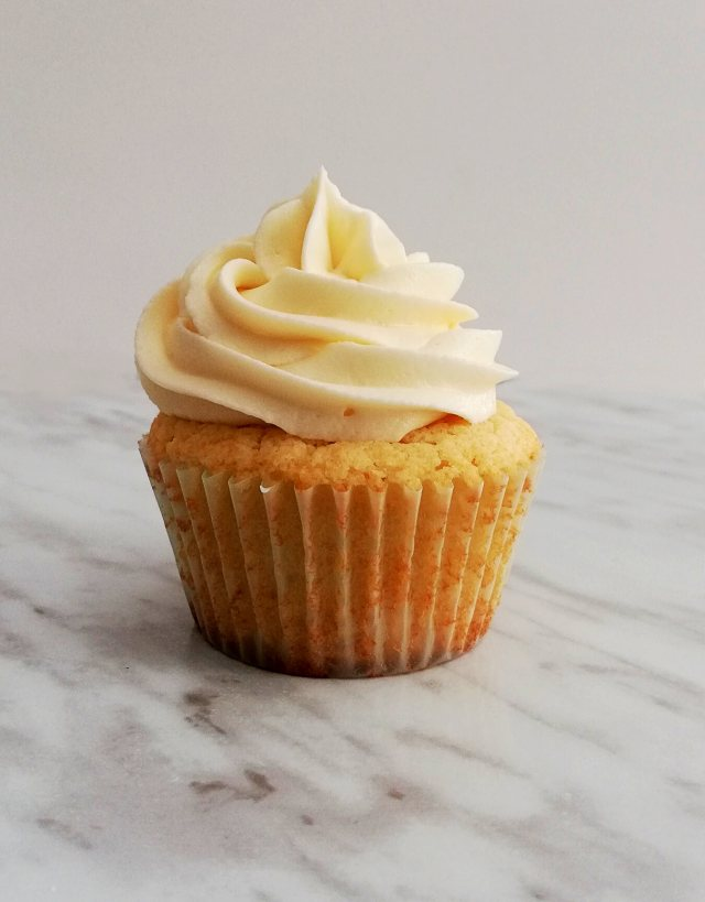 sour cream vanilla cupcakes one frosted