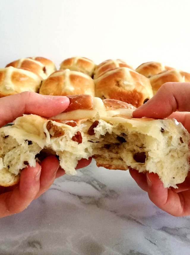 Easter hot cross buns tearing one open