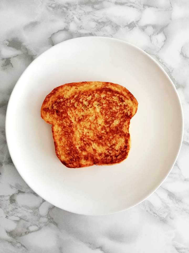 French toast plain slice in plate overhead