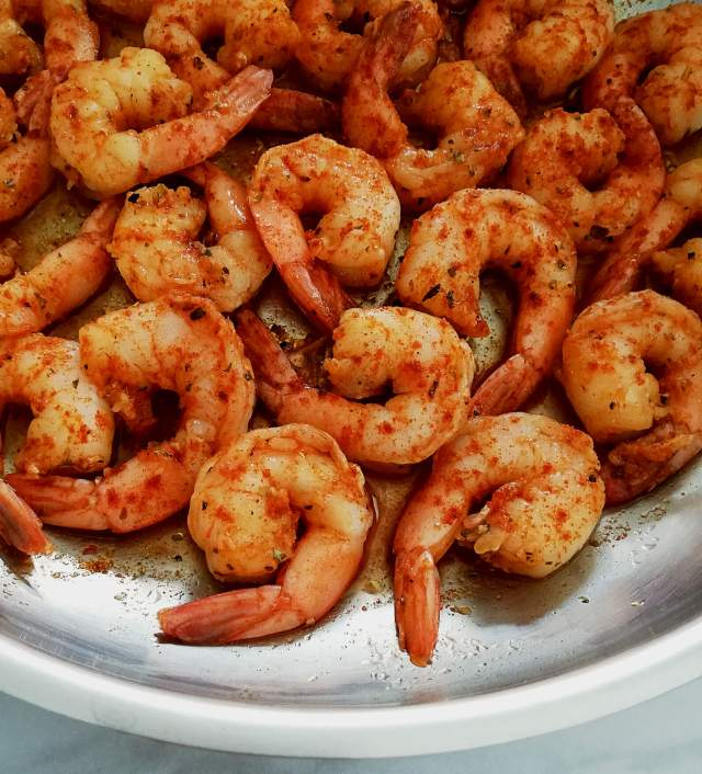 spicy shrimp in skillet plain close up