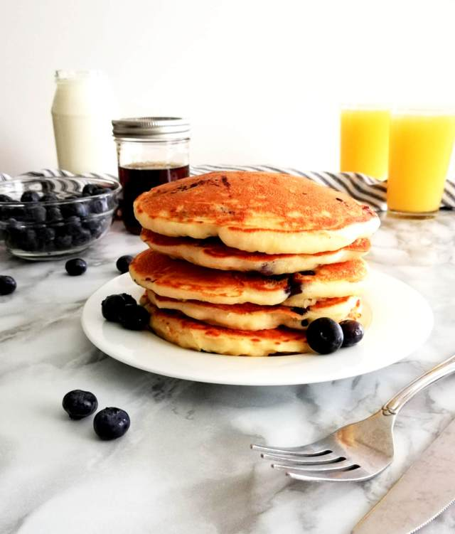 blueberry pancakes stacked in plate head on view