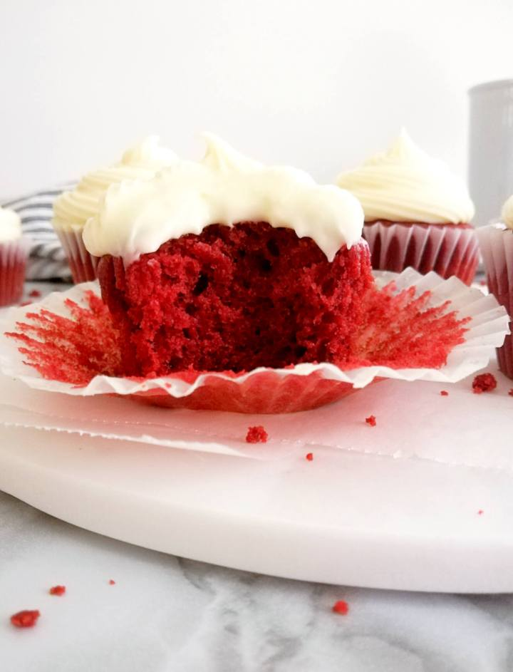 red velvet cupcakes bite from one cupcake