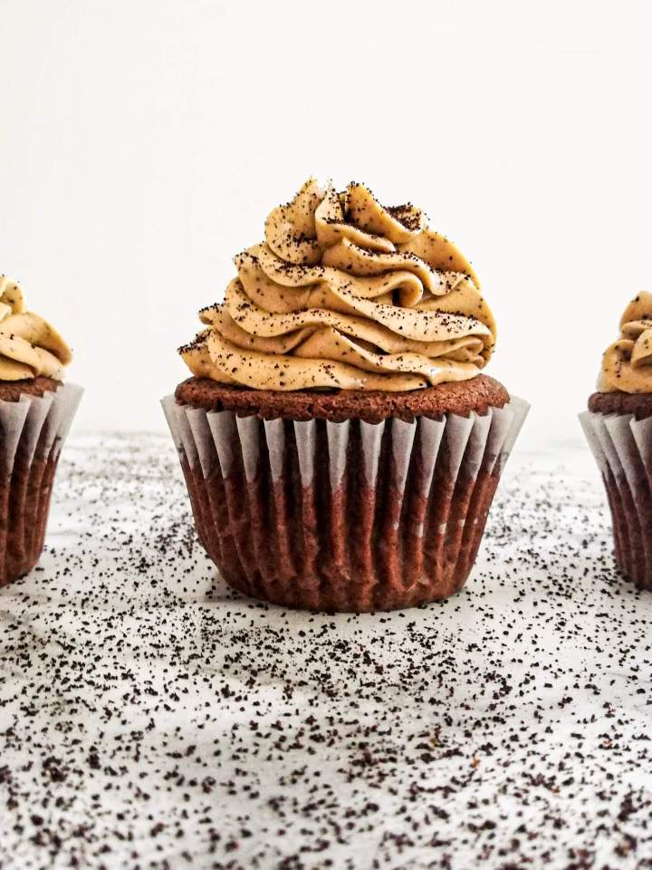 chocolate espresso cupcakes frosted and sprinkled with coffee granules