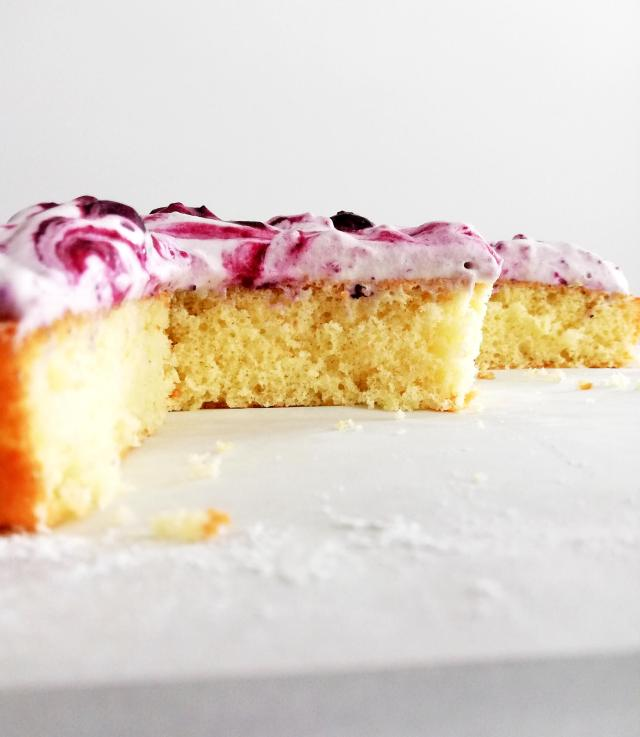 genoise cake with blueberry swirl whipped cream cake sliced side view